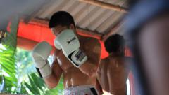 Muay Thai Boxing Fighters Athletes Training In Ring Combat Sport Gym Hand Held Stock Footage