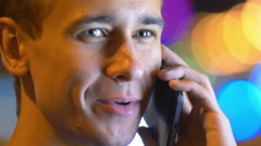 6 in 1 video! Man phone and smile by bright lights background. Real time capture Stock Footage