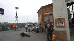 Group of street performers singing on the street in Berlin Stock Footage
