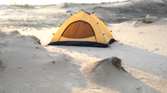 A lone tourist camp tent in a desert sand place Stock Footage
