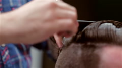 Beard barber making haircut to hipster client Stock Footage