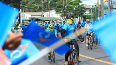 "PHUKET AUGUST 16 : Unidentified Cyclist in prepared ""Bike for mom"", event show r Stock Footage"