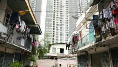Slum houses against modern apartment tower, sliding parallax shot Stock Footage