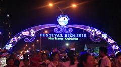 People walk about resort city streets at festival at night Stock Footage