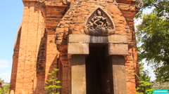 View of old tower at ruins of culture centre Tháp Bà Ponagar Stock Footage