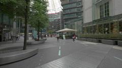 Walking in the Sony Center plaza in Berlin Stock Footage
