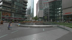 Taking pictures of a little boy at the Sony Center Plaza in Berlin Stock Footage