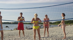 Group of Young People playing in Volleyball on the Beach - stock footage