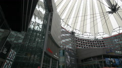 The Sony Center Plaza with cinemas and Starbucks Coffee in Berlin Stock Footage