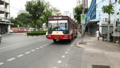 Noisy daytime traffic at Rama IV road, public bus loudly drive aside Stock Footage