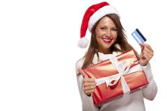 Smiling woman purchasing Christmas gifts Stock Photos
