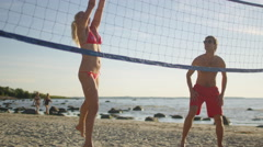 Girl is Playing in Beach Volleyball with Friends - stock footage