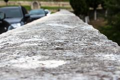 Photo of old stone ruined curb - stock photo