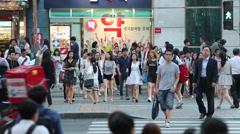 Pedestrians crossing the street in Seoul's prestigious Gangnam district. Stock Footage