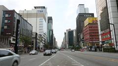 Traffic passes through Seoul's prestigious Gangnam district. Stock Footage