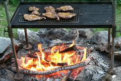 Cooking barbecue steak - stock photo