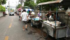 Camera move along many street food vendor carts, typical Thai snacks and meals Stock Footage