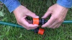 Man fixing and connecting watering hose Stock Footage