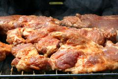 Cooking barbecue steak Stock Photos