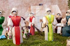 Traditional slovak corn dolls - village scene - stock photo