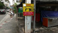 Beware bag snatching sign at the street, POV camera walk aside, inner-city area Stock Footage