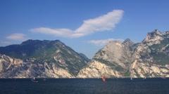 Surfing on Garda Lake in Italian Alps - stock footage
