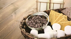 Ingredients smores dip prepared with large marshmallows in cast iron pan. Stock Footage