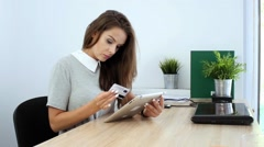 8.mp4Young businesswoman rewriting data from credit card to tablet pc Stock Footage