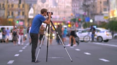 6 in 1 video! Man stand on the street and shoot with camera with tripod Stock Footage