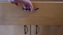 FEMALE HAND REMOVES A WHISK OUT OF THE DRAWER.  NUMBER 5 IN A SERIES OF 5. Stock Footage