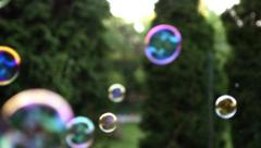 Close up of soap colorful bubbles floating in the air Stock Footage