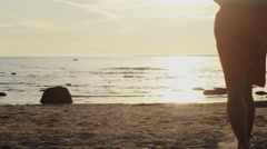 Group of Young People Running into Water in Sunset Light. Slow motion 60 FPS. - stock footage