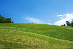 Stock Photo of Green Hill Blue Sky