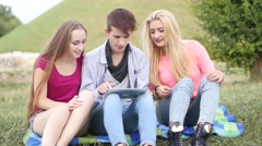 Three friends playing game on tablet pc. They winning again. Stock Footage