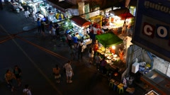 Street food and fruits stalls on night Sukhumvit 38 alley, view from above Stock Footage