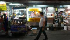 Traditional Thai meals at night street stalls and movable kiosks, parallax shot Stock Footage