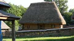 An old thatched roof house at the museum in Sibiu - stock footage