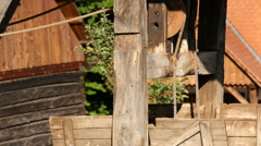 Wooden well with pulley at the Open Air Museum in Sibiu - stock footage