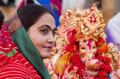 JAISALMER, INDIA - SEPTEMBER 9th: Devotees and  the statue of Lord Ganesha du - stock photo