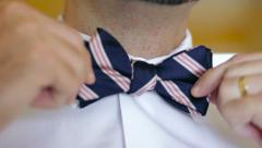 Man Putting On Bowtie Stock Footage