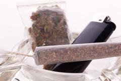 Close up of marijuana and smoking paraphernalia - stock photo
