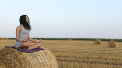 Woman Meditation relaxation in the Field 03 - stock footage