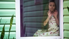Sad Girl Sitting At Window And Looking At Rain Stock Footage