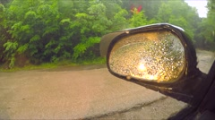 Rain Drops On Car Side View Mirror And Window Stock Footage