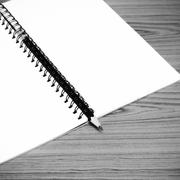 Notebook and pencil black and white color tone style Stock Photos