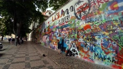 Painted graffiti wall in Prague. Lennon Wall. 4K. Stock Footage