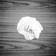 wiriting idea word on crumpled black and white color tone style - stock photo