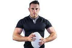 Tough rugby player looking at camera - stock photo