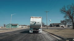 Garbage Truck Driving Down Street - Daytime Stock Footage