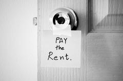 sticky note write a message pay the rent black and white color tone style - stock photo